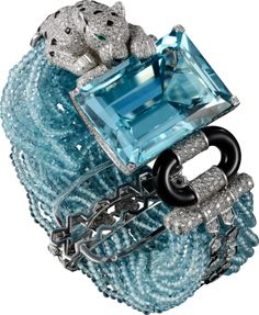 CARTIER. Bracelet - Platinum, one 86.69-carat rectangular-shaped aquamarine, aquamarine beads, onyx, emeralds, brilliant-cut diamonds. #Cartier #CartierMagicien #HauteJoaillerie #FineJewelry #Panthère #Diamond #Aquamarine #Onyx