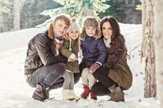 Winter family photos, family portraits, family pictures, mother, mommy, daughter, girl, father, daddy, son, boy, hugs, snow, hat, scarf, trees, sun, Christmas, holiday.