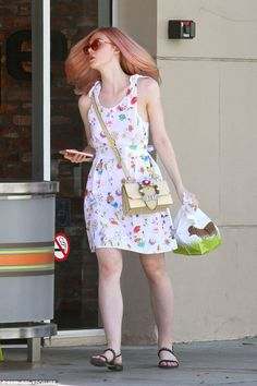Moo: The star appeared to have picked up some grub to go as she exited Burger Lounge...