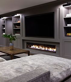 When it comes to outfitting the ground floor in your home, a basement fireplace will up the ante. We're talking instant warmth and ambiance. Here are eight basement fireplace ideas to inspire your decor. Basement Fireplace, Basement Flooring, Fireplace Ideas, Fireplace Remodel, Basement Bathroom, Flooring Ideas, Fireplace Console, Paneling Ideas, Cozy Basement