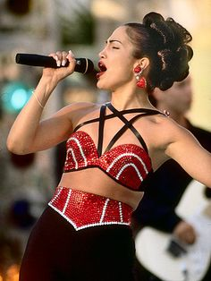 Jennifer Lopez as Selena. My favorite up doo! And love the outfit too