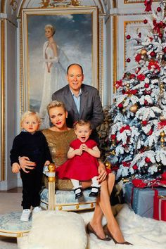 Princess Gabriella looked especially cute, perched on her mother's knee and grinning open mouthed at the camera, while her cherubic brother looked adorably solemn. Princess Charlene of Monaco shined as she was photographed with her husband Prince Albert and their adorable twins for their Christmas card photo. Princess Charlene stunned in a glimmering Ralph Lauren dress with complimentary brown suede Jimmy Choo pumps.