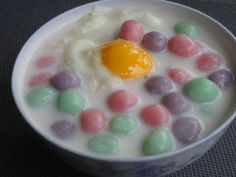 Another desert you just have to try in Thailand Bua Loi: Soft and sticky dough balls served in mildly sweet warm coconut milk sometimes with syrup-poached eggs on top. Different coloured balls are made from sticky rice flour with different flavours including taro, sweet potato, pandan, pumpkin, etc