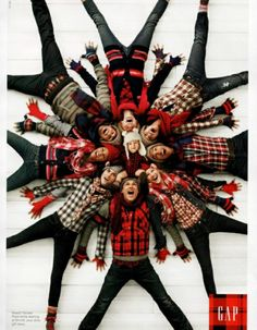family Christmas card photo idea, christmas sweater fun for a big family. extended family cousins. even with an ugly sweater theme