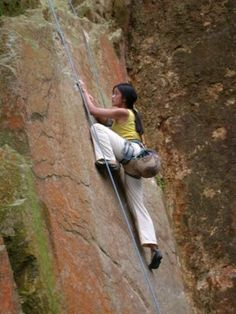 The best thing you can do to get better at rock climbing is to climb more.  A lot of newbies I've introduced to rock climbing often feel they need to build up more strength before they can start rock climbing in earnest, but this is a mistake.  If...