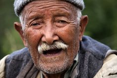 """THE 102 YEAR OLD CONVERSATIONALIST,Uttarakhand  He's headed back home in the evening, herding the cows back from grazing. He's a 102 years old, razor sharp wit, breaks into laughter easily, his senses all intact, other than the cataract visible in his eyes. He still has the enthusiasm to stop a passerby, a complete stranger,  and have a long conversation. """" My eyes bother me, I'm too young to be having problems with my eyes."""" he says and bursts into laughter, full of glee at his own humor."""