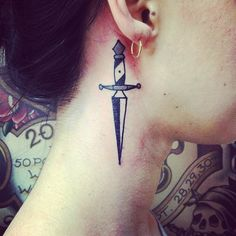 Dagger behind ear.