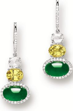 YELLOW SAPPHIRE AND DIAMOND PENDENT EARRINGS The pendent earrings each suspending on an oval jadeite cabochon of emerald green colour and good translucency, surmounted by an oval yellow sapphire and a rose-cut diamond. #DiamondEarrings #ShaunaGiesbrecht #VonGiesbrechtJewels
