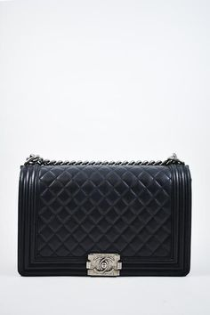 2398f3cbd03566 Chanel Black Calfskin Medium Boy Bag Leather Overnight Bag, Overnight Bags, Chanel  Handbags,