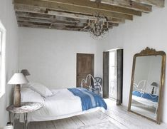 Simple and green.  This room is a great example of how simple it is to go green.  Recycled wood flooring, antique furniture.  Lamps made of wood. Organic linens on the bed.  We can only hope that the paint and stain are organic and free of chemicals.  Simple and gorgeous.  Love this bedroom.