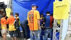 Barcelona supporters sign vote of no confidence outside the Camp Nou
