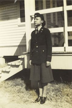 Gertrude Margaritte Ivory-Bertram stands outside a building, probably at Fort Bragg, N.C., in her ANC blue service uniform, circa 1943.