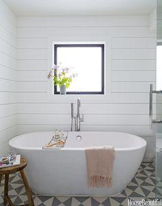 Wyndham Collection Soho soaking tub, $1399, Home Depot, Priya freestanding tub filler, $1499