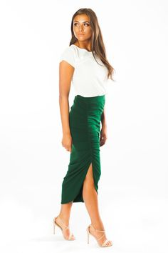 Marina Midi Skirt by Ariana James | The Marina Midi Skirt is a classy, yet simplistic staple for easy transitioning from the breezy days of spring, to the warm days of summer, to the brisk days of fall. Available in 8 colors, the rich huess of the comfortable cotton fabric make this skirt perfect for taking you from a day at the office to a night out on the town. Feel confident as you transform your look with key accessories from your own collection, styling the skirt to your personality.