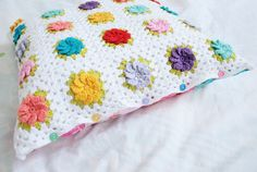 Granny square cushion, colorful buttons