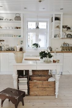 love the white table as an island and all of the accessories