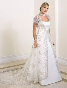 #weddings #bridal #brides | Plus Size Wedding Dress for Winter - Bridal Over Coat with train for Winter Wedding - This short sleeve bridal jacket is embellished with beaded lace - Our design firm can create this look for you in any size and with any changes. We are located near Dallas but offer custom bridal gowns and affordable replicas of couture wedding dresses to brides all over the globe.  www.dariuscordell.com/featured/plus-size-wedding-dresses-bridal-gowns/