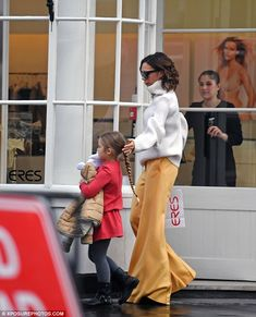 Star factor: Despite the lack of sunshine, the brunette covered her face with a pair of ov...