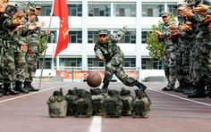 Soldiers of Chinese People's Liberation Army bowling in Jinan.