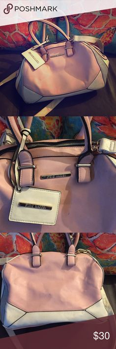 Steve Madden hand bag This is a two-tone beige and salmon Steve madden shoulder bag very spacious has a handle and a strap multiple compartments on the inside zips as well smoke free pet free home happy poshing cheers 🎉🍾 Steve Madden Bags Shoulder Bags
