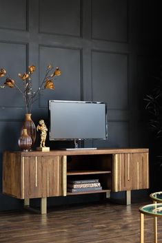 #eclectichome #tvstand #livingroom #woodenfurniture #storagecabinet #storageideas #quirkyhome #eclecticdecor #quirkyinteriors #vintagehome #antiquestyle #haberdashery #homestorage #storagesolutions #rockettstgeorge Tv Entertainment Units, Rockett St George, Declutter Your Home, Wooden Cabinets, Eclectic Decor, Brass Metal, Mid Century Design, Contemporary Interior, Open Shelving