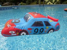 Pool party ideas - use fun inflatables like this large race car for pool party games and floating pool decorations.