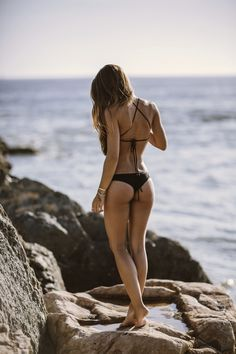 On the beach in her thong bikini.