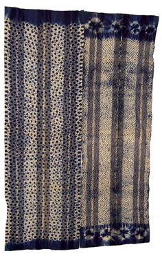West Africa | Wrapper made from two wide strips of cotton; The cloth has been tie, and stitch, dyed, with indigo. Stitch dying is more prominent on the right half. | ca. prior to 1934.