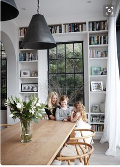 Love the bookshelf wall surrounding the windows.  Adds a lot of character to the dining room!