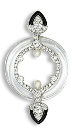 AN ART DECO ROCK CRYSTAL, DIAMOND, ONYX AND PEARL BROOCH, BY CARTIER  Designed as a rock crystal hoop with circular-cut diamond interior and pearl detail to the onyx and diamond palmette terminals, pearls untested, circa 1920, 5.6 cm wide, with French assay marks for platinum Signed Cartier, number indistinct