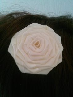 Beautiful cream color rosette $4, sold on Etsy.com or facebook By Snazzie&Classie Hair Accessories an more.
