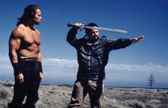 "Arnold Schwarzenegger and director John Milius behind the scenes of ""Conan"""