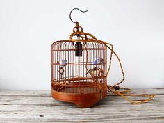 Vintage Bamboo Birdcage Hanging Light with Fabric Cord via Etsy.