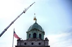 Maintenance being done on the Blessed Mother's halo on top of Villa Maria at Immaculata University.