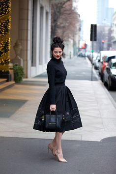 Skirt: Alice & Oliviavia Shopbop ℅ | Turtleneck: J.Crew (similar style here) | Pumps: Christian Louboutin (similar style under $300here) | Bag: Celine (love this similar style) | Earrings: J.Crew (similar styleunder $100 here) …. Here's a look I wore before Drew and I headed out to dinner here in Italy! This city is beyond [&hellip