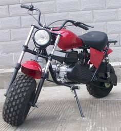 ****MODEL DISCONTINUED, see new model with TORQUE CONVERTER.****** 6.5hp, Gear Reduction Jackshaft, HUGE TIRES, Suspension, Headlight, Rear Rack, Fenders. in stock ready to ship. some assembly required. black only