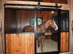 A more rustic style for the horse stalls. I really love that flat track for the sliding stall door.