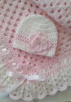 This beautiful hand crocheted granny square baby blanket is made of 100% baby soft yarn. It is made out of a very good high quality yarn. Very soft and colorful blanket set. Beautiful hand crochet baby blanket and baby beanie hat in light pink and white colors. White satin ribbon
