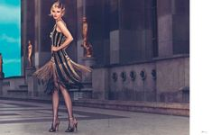 fantasy dress and shoes....Natalia Siodmiak takes in the sights of Paris in a jazz age inspired story for Elle Ukraine's April issue.