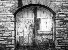 """Unsure who created or posted it, I assume it's a photograph but I like the idea as the door is illustrated damaged shown through the worn out paint, which gives it that scary and mysterious feeling of what is behind that door. A door can look hideous from the outside but we will never know what lies behind it until we enter it.  """"Don't judge a book by its cover"""""""