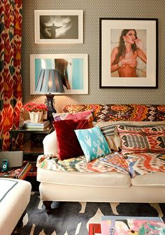 Love fabric over sofa w mix of pillows and curtain print