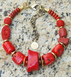 Bold Red Coral and Gold Statement Necklace I just designed this simple but bold statement necklace for a client using a mix of some of her beads and some of mine. It is a beautiful combination of red bamboo corals, sponge coral, cinnabar and brilliant gold. Although this is a custom design, I can make a similar piece. Contact me if you are interested: kelly@xogallery.com