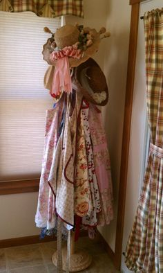 My collection of favorite aprons (on a coat rack)