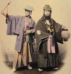 Two Japanese samurai in fire dress, circa 1865. The one on the left wears a jingasa hat, and the one on the right wears the traditional indigo tabi socks of the samurai firefighter. (Photo by Felice Beato)