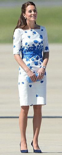 LK Bennett 'Lasa' Blue Poppy Print Dress  The Duchess looked radiant wearing this poppy print LK Bennett sheath dress as she disembarked from the plane at the Royal Australian Air Force base near Brisbane during the Royal Tour Down Under.  The LK Bennett Lasa dress is a silhouette-skimming style adorned with snorkel blue poppies, arranged in an artful print against a white backdrop.  It has a square neckline and elbow length sleeves.