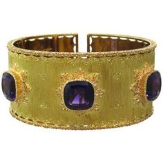 "Beautiful 18k gold cuff with 3 10.5mm x 10.3mm amethyst gemstones DESIGNER: Buccellati MATERIAL: 18K Gold GEMSTONE: Amethyst DIMENSIONS: Bracelet will fit up to 6"" wrist and is 28mm WEIGHT: 61.2g MARK"