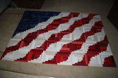 Curved Log Cabin blocks simulate a flag. by betsy