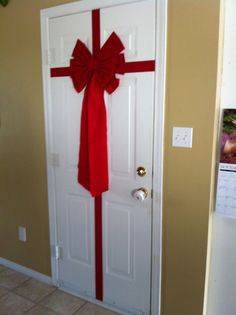 Dollar store ribbon & bow turns a door into a cheap present(decoration) ;)