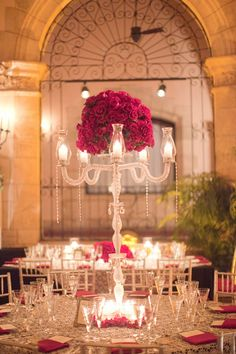 The centerpieces were full of Black Magic roses in vintage style candelabras with hanging crystals.  Photo by Jessica Lorren Organic Photography