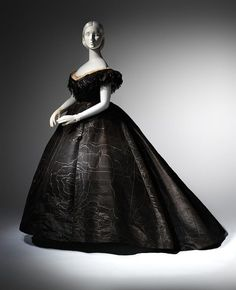 "The Metropolitan Museum of Art recently announced a breathtaking new exhibit, ""Death Becomes Her: A Century of Mourning Attire"" Evening dress suitable for late mourning, from around 1861 (Posted on Dangerous Minds)"